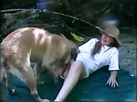 Woman and her dog having dog sex in nature